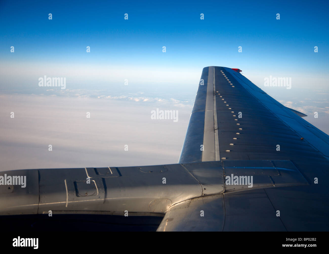 Overcast clouds - view from the window of a jet aircraft - Stock Image