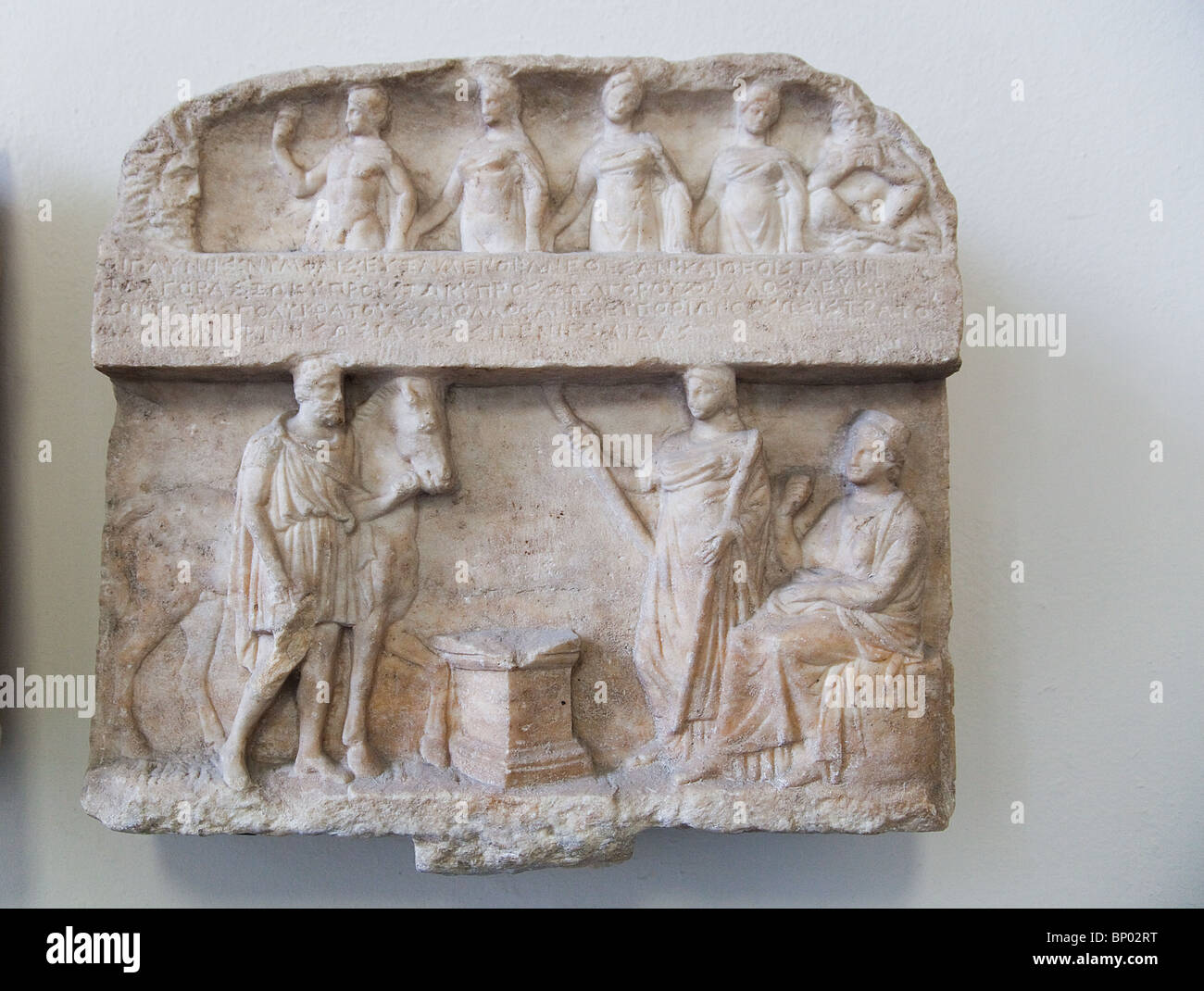 Pergamon Museum artifacts in Berlin, Germany 'Top: Hermes guiding Nymphs and Pan top. Bottom: Heros with Demeter - Stock Image