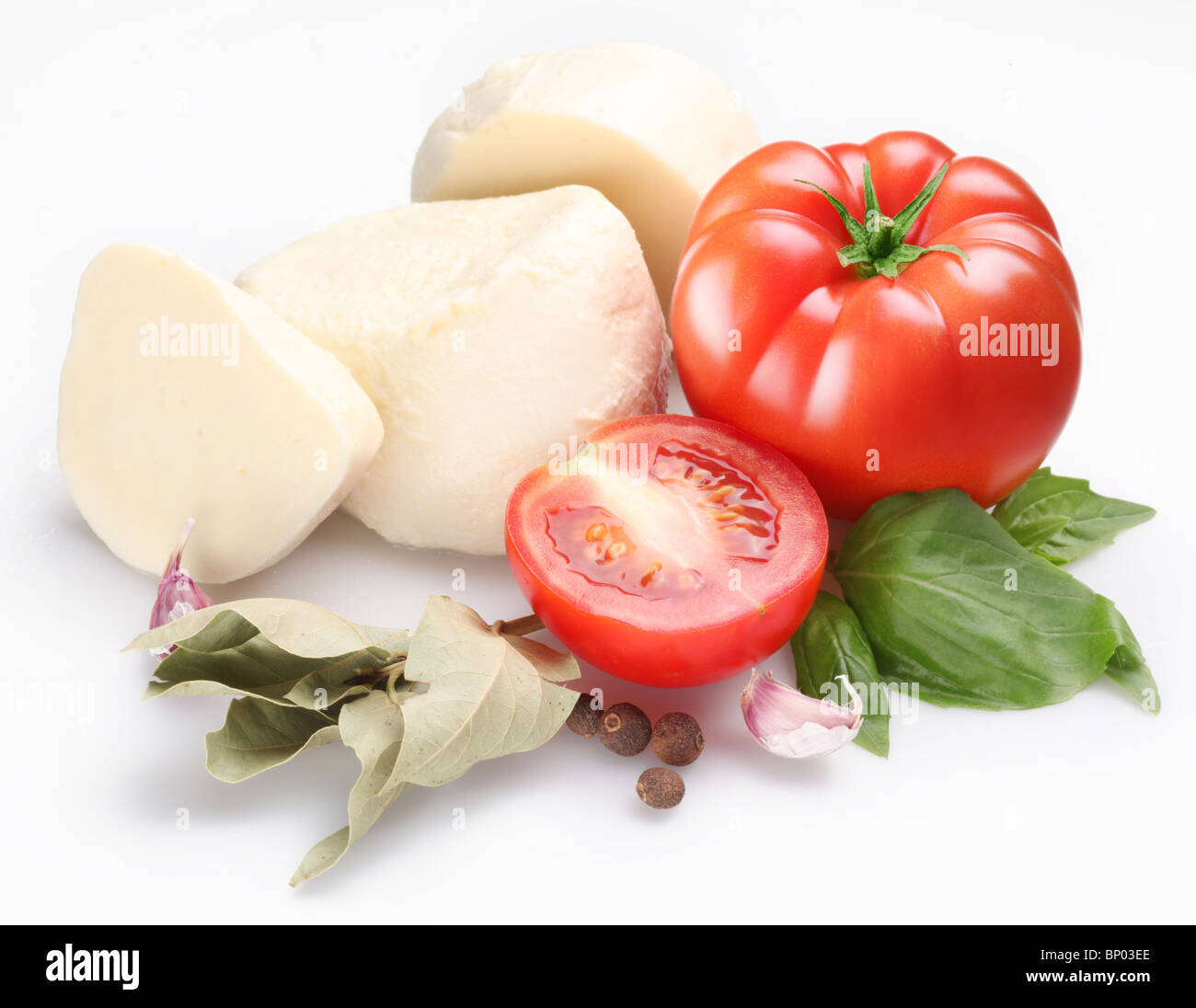 Ingredients for making salad with mozzarella and tomatoes on a white background. - Stock Image