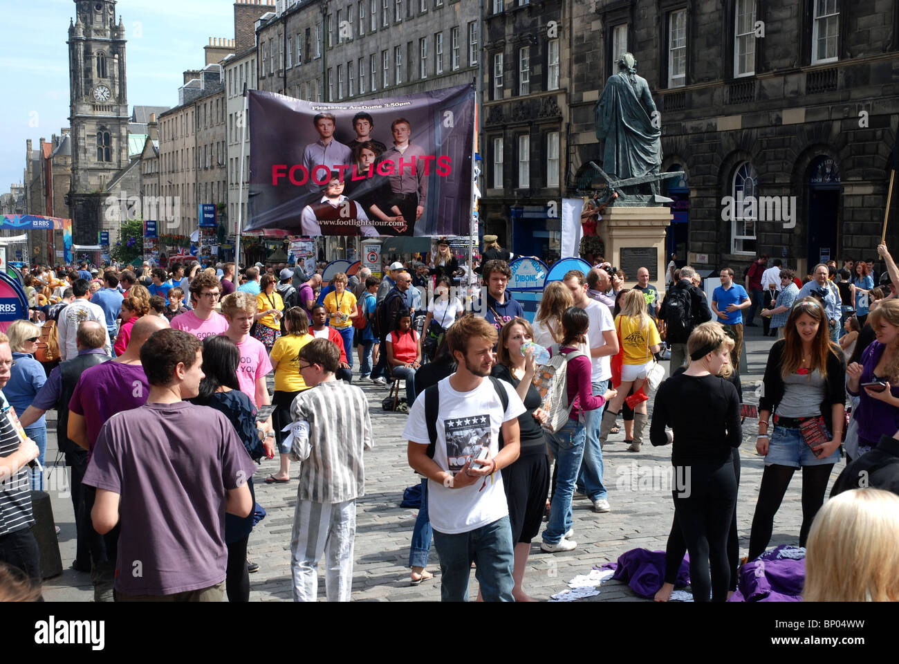 Performers from the Edinburgh Fringe Festival promote their shows on the Royal Mile in Edinburgh, Scotland, UK. - Stock Image