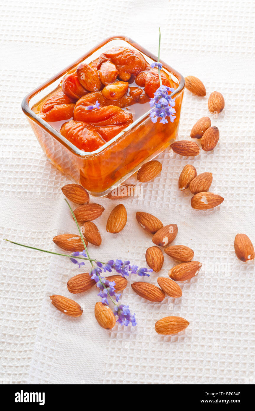 Apricot jam with almonds - Stock Image