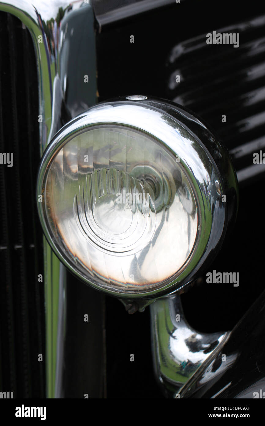 classic car detail - a 1935 Standard 8 headlamp - Stock Image