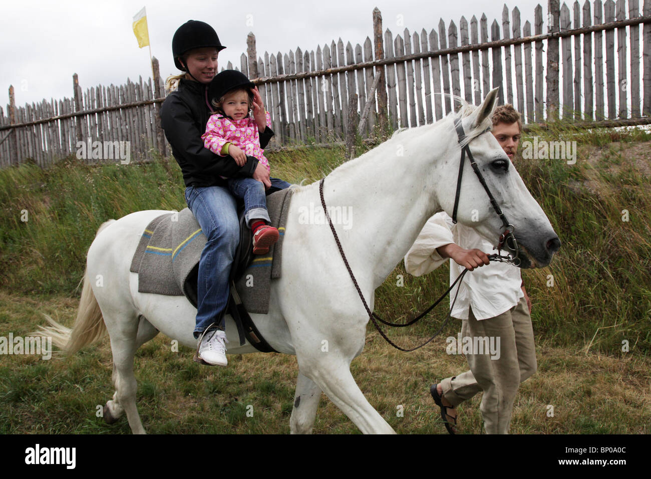 Children's horse trip at Finland's biggest Viking Market Festival at Kvarnbo on Åland archipelago - Stock Image