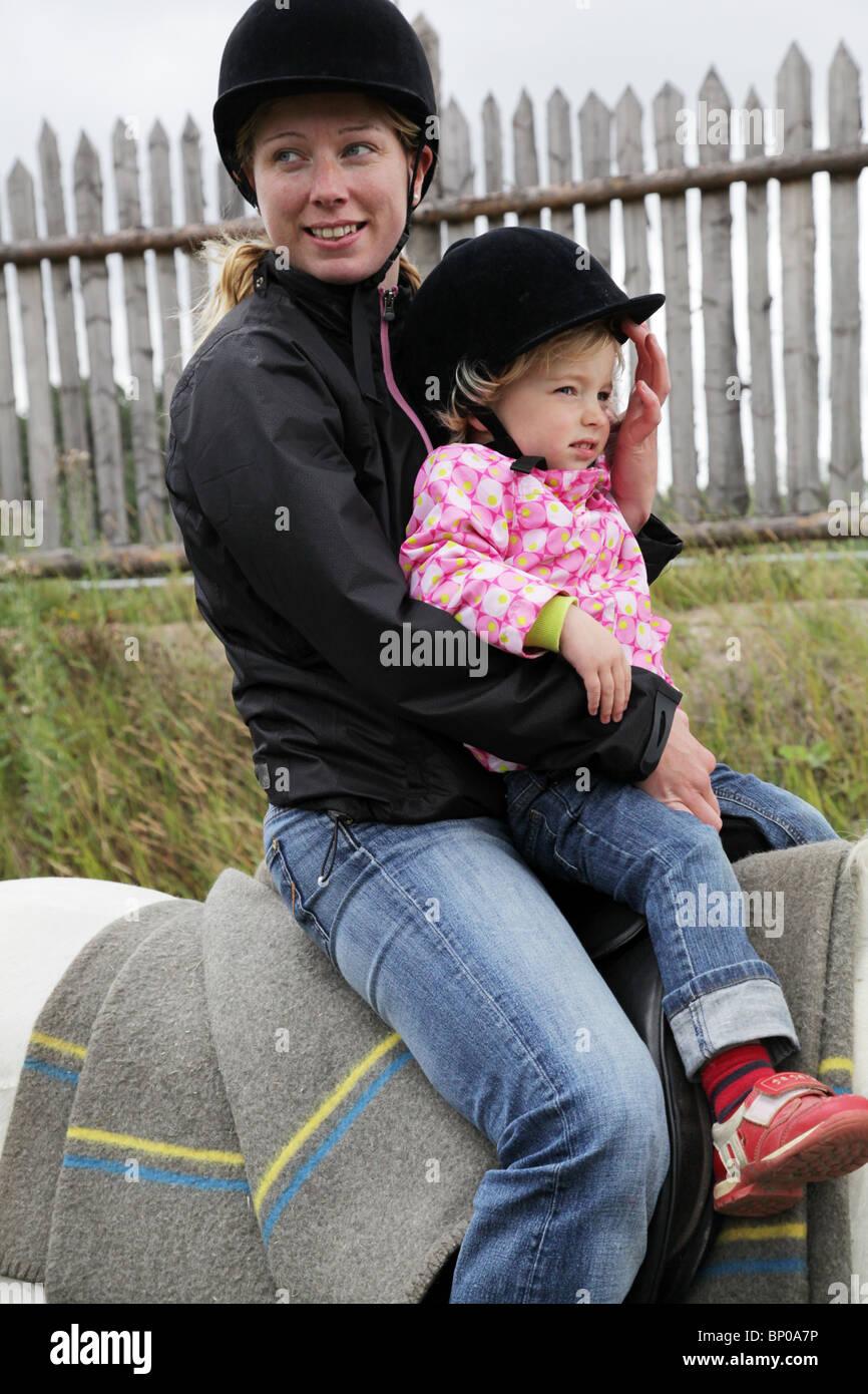 Children's horse trip at Finland's biggest Viking Market Festival at Kvarnbo on land archipelago - Stock Image