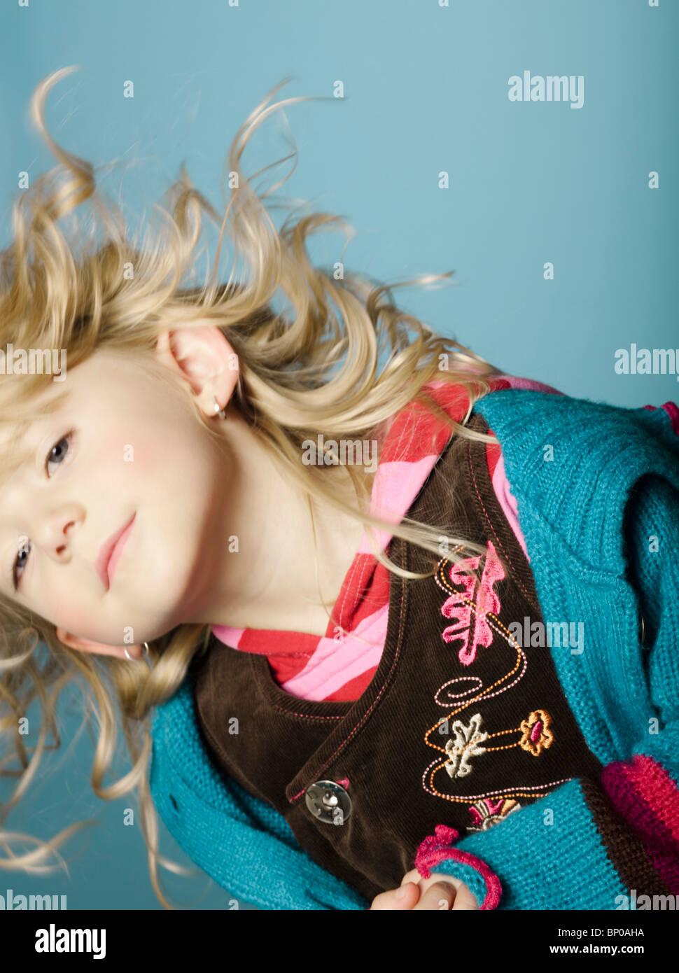 Little girl moving her head - Stock Image