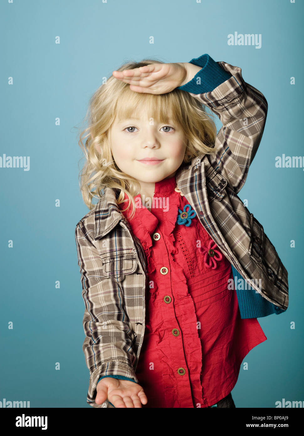 Little girl with hands measuring size - Stock Image