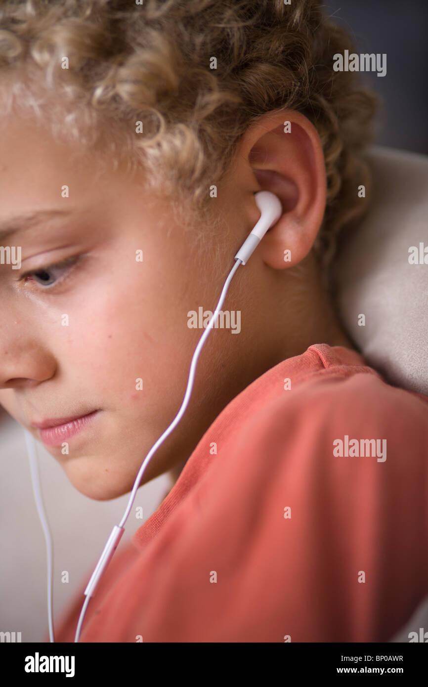 Boy with earphones - Stock Image