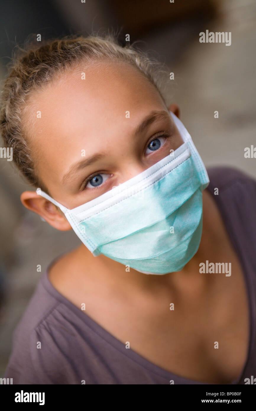 Girl with swine flu mask - Stock Image