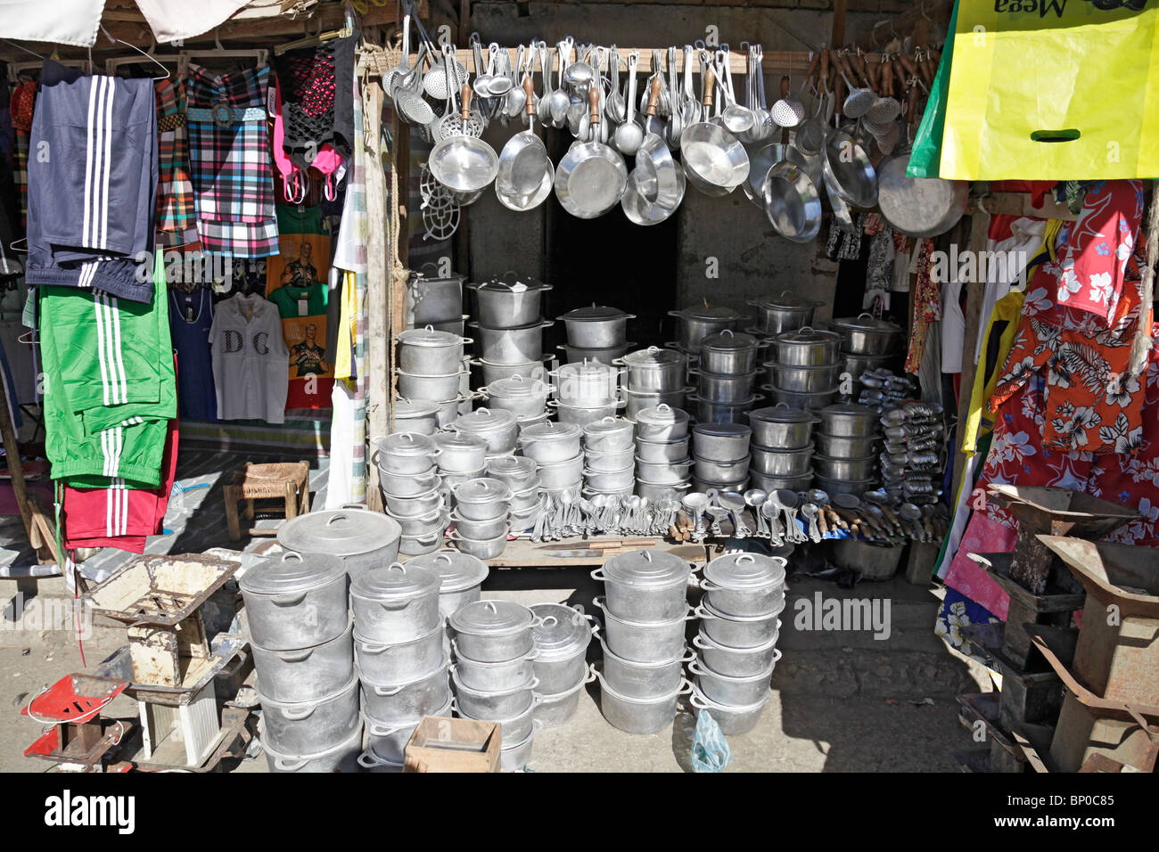 Household goods like pots and pans in a stall in the market at Toliara / Toliary / Tulear, south-west Madagascar - Stock Image