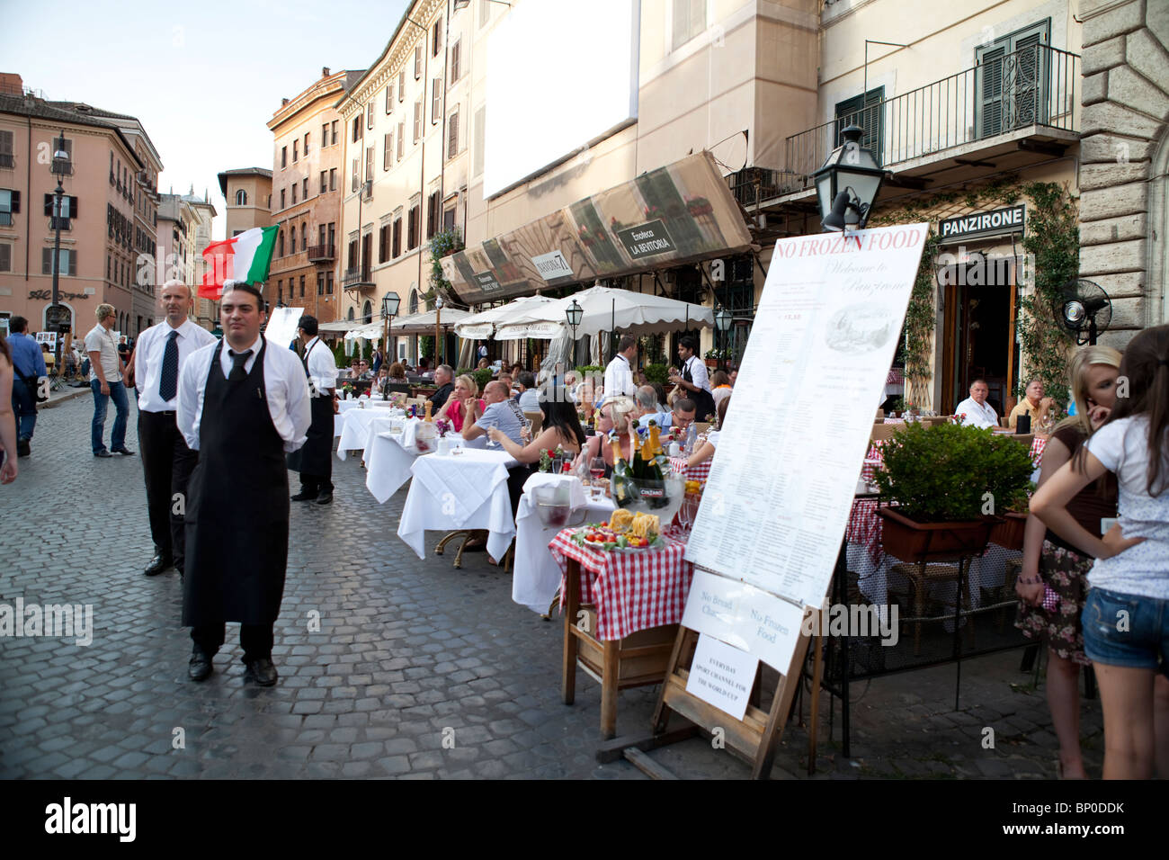 Waiters calling tourists at their restaurant .Italy, Rome, Piazza Navona. - Stock Image