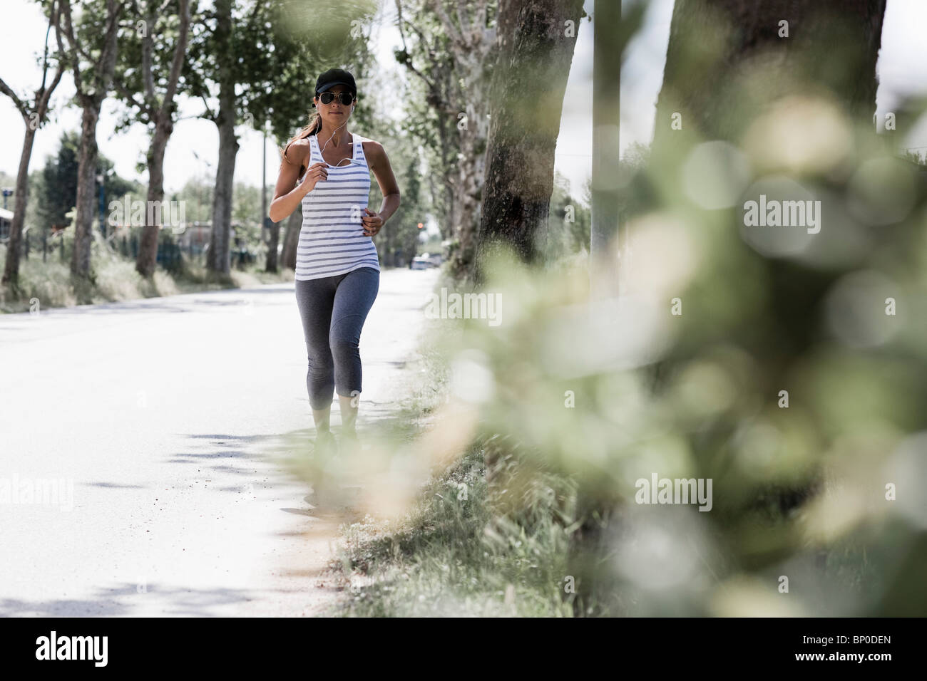 Woman jogging on a street Stock Photo