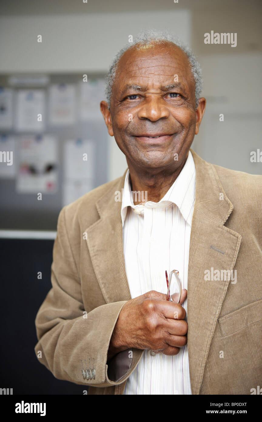 Elderly black man smiling - Stock Image