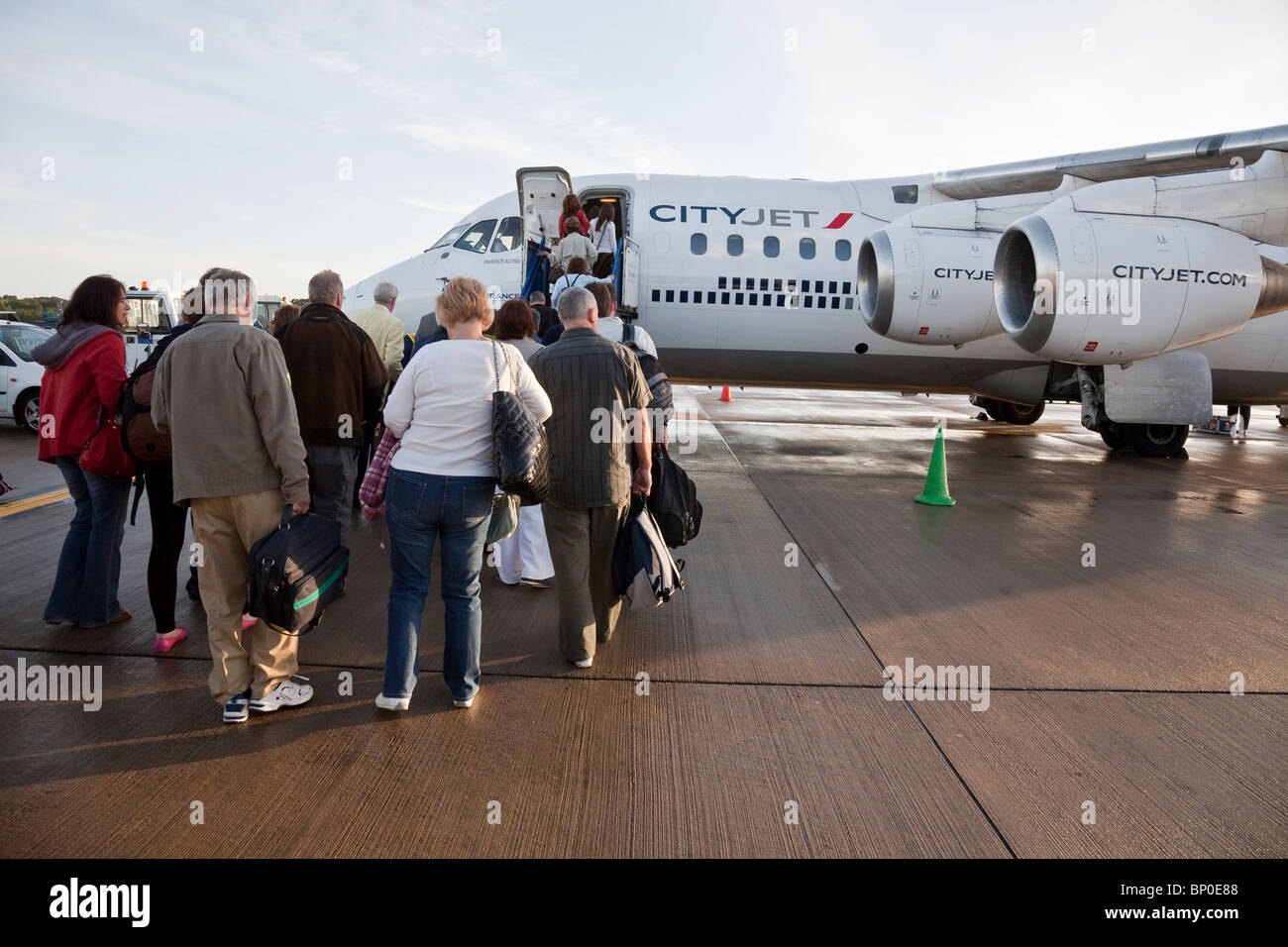 People boarding a CityJet aeroplane at Edinburgh Airport - Stock Image