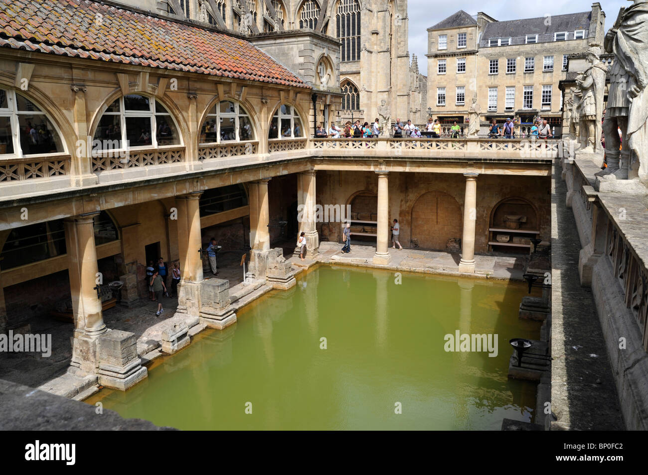 Roman Baths and Bath Abbey Church in the Background - Stock Image