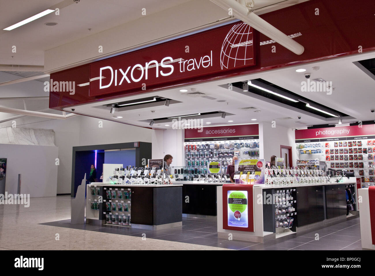 Customers and staff at the Dixons travel outlet at Edinburgh Airport, Scotland, UK Stock Photo