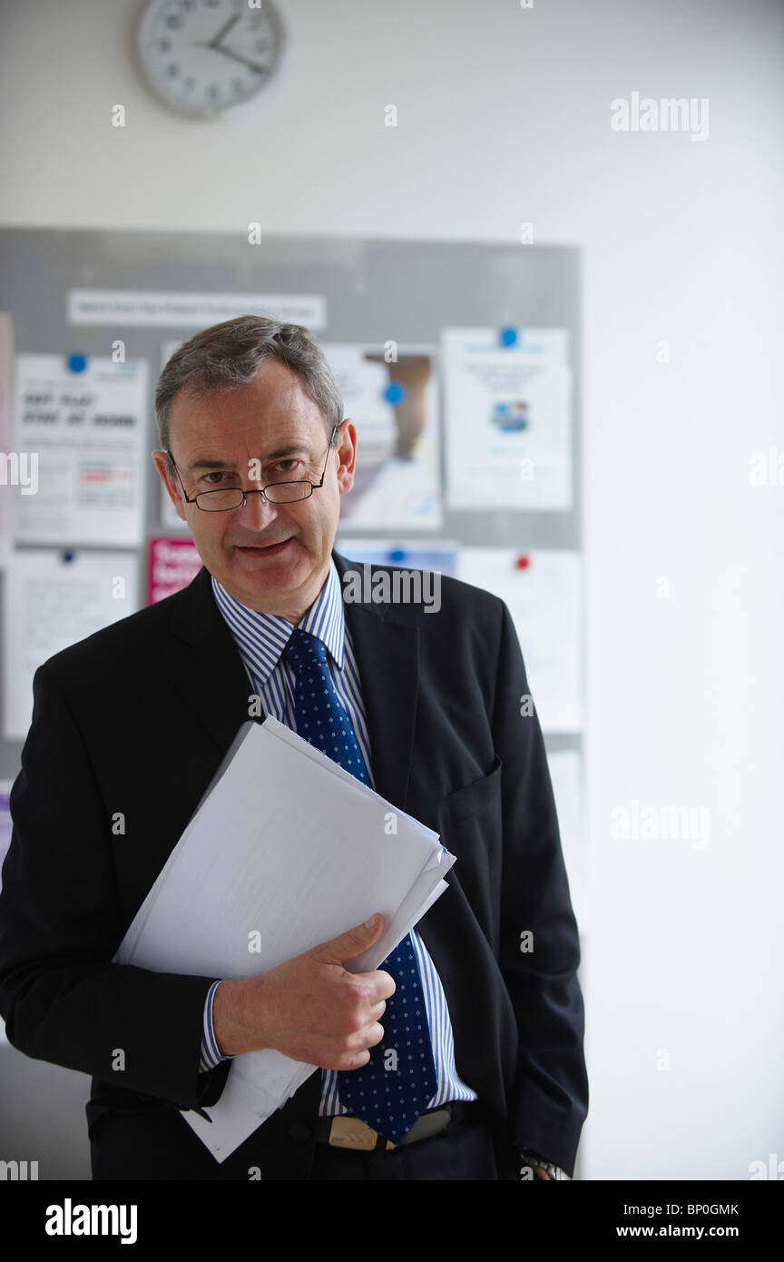 Medical Consultant holding paperwork - Stock Image