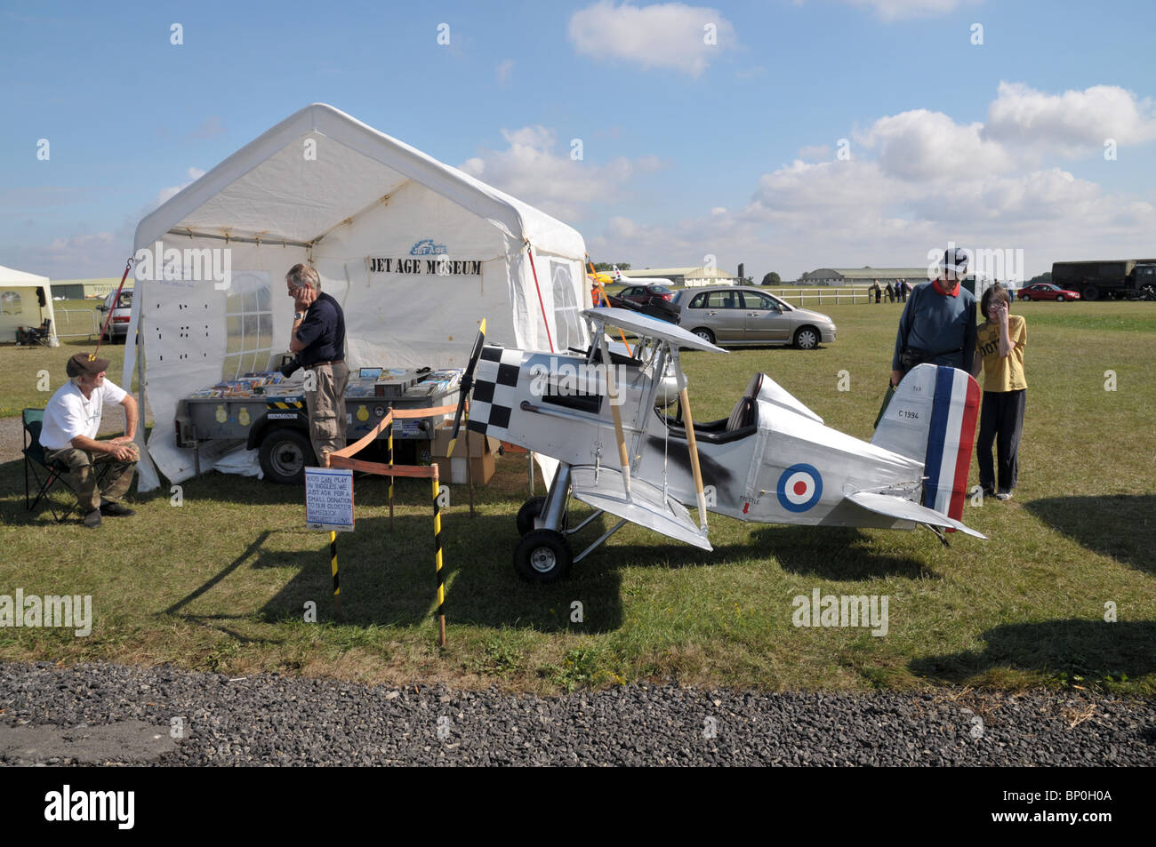 a little bi plane model that a charity has made to scale to help raise money as a childrens ride for a donation.steam - Stock Image