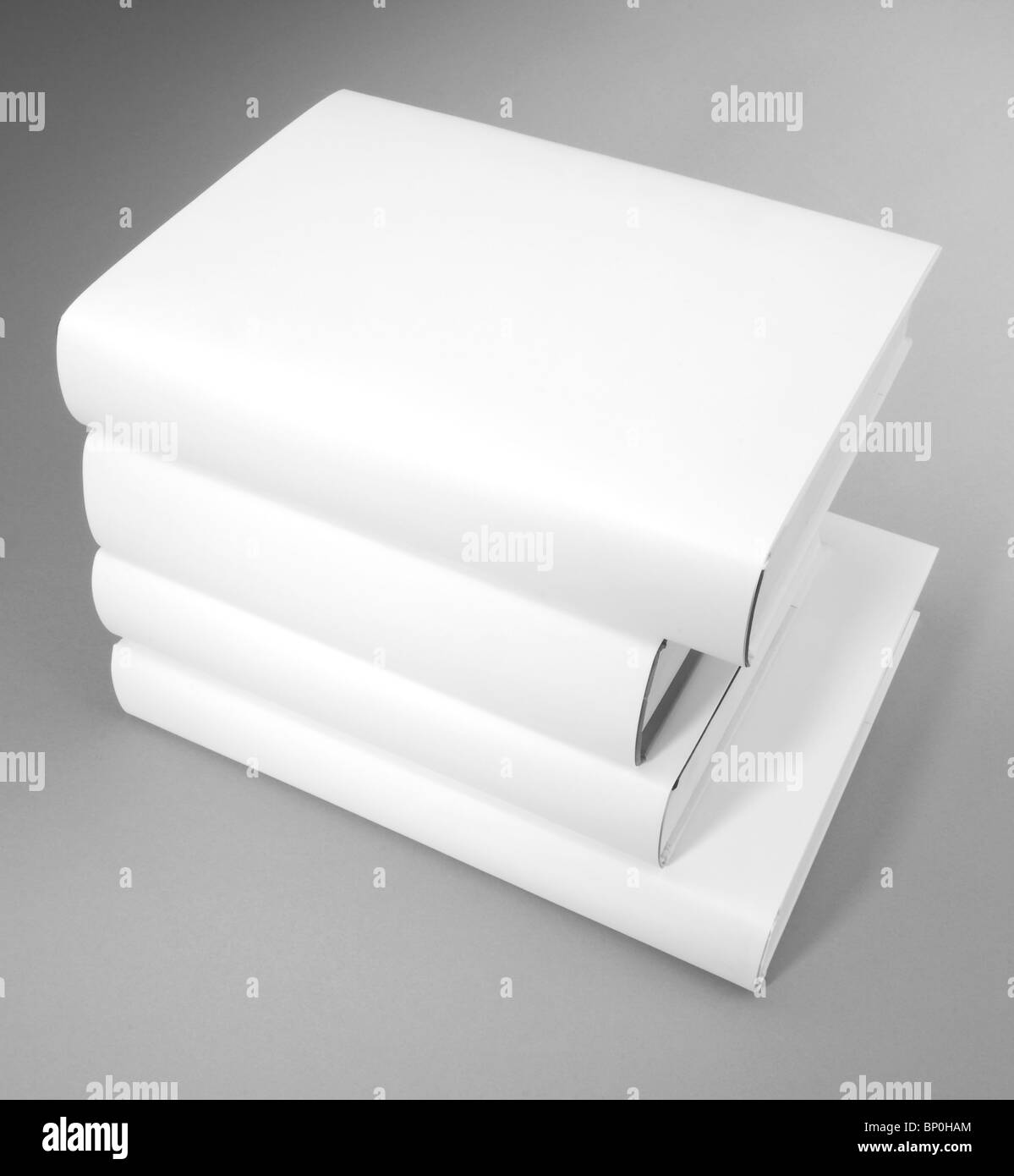 A pile of various size of hardcover books - Stock Image