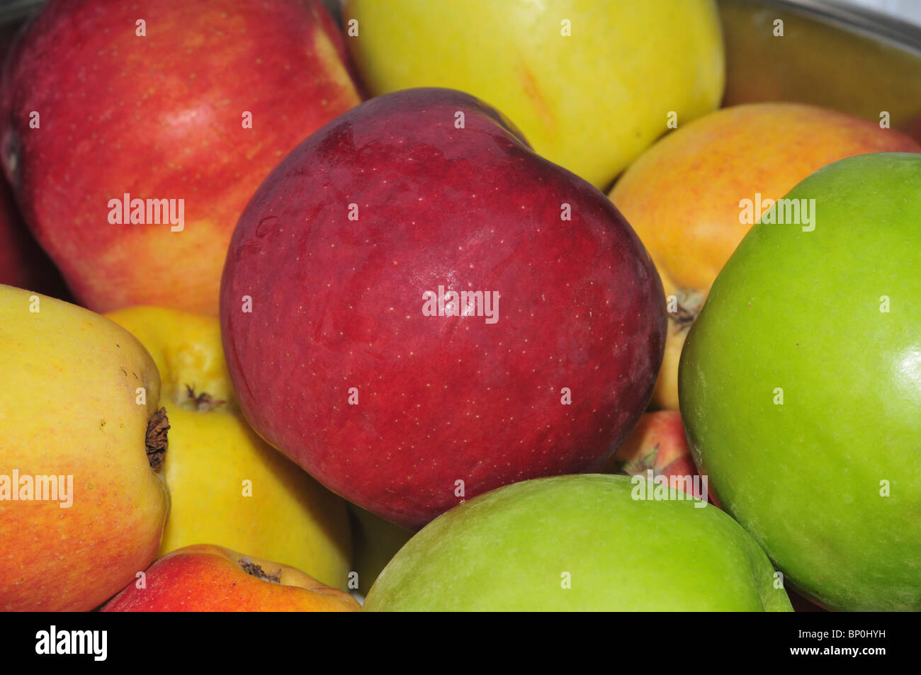 A bowl of red and green apples - Stock Image