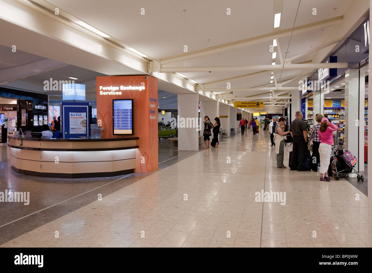 Main concourse at Edinburgh Airport. Scotland, UK, showing the Foreign Exchange desk, a WHSmith shop and some passengers. Stock Photo