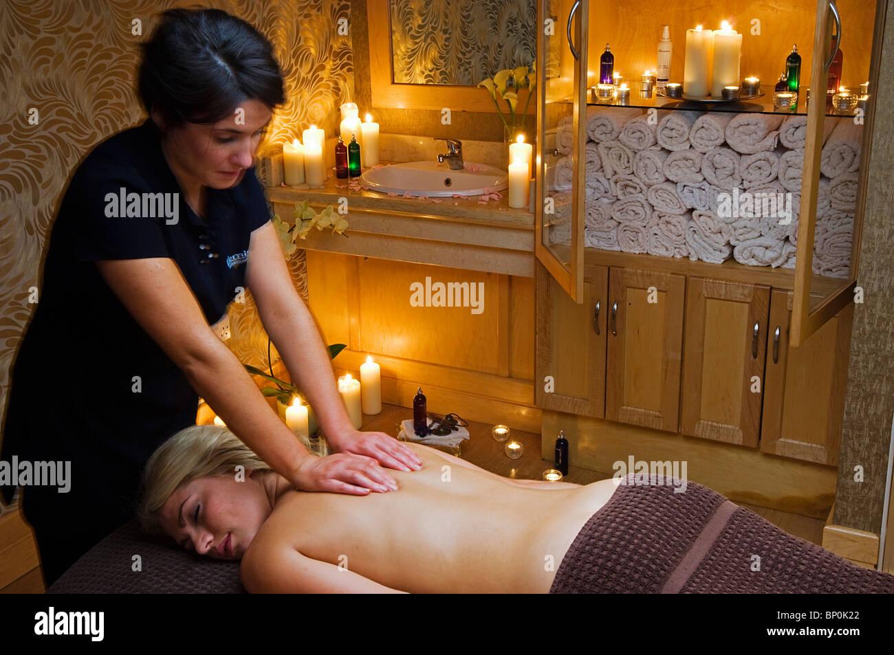 northern ireland, fermanagh, enniskillen. a girl enjoys a massage in