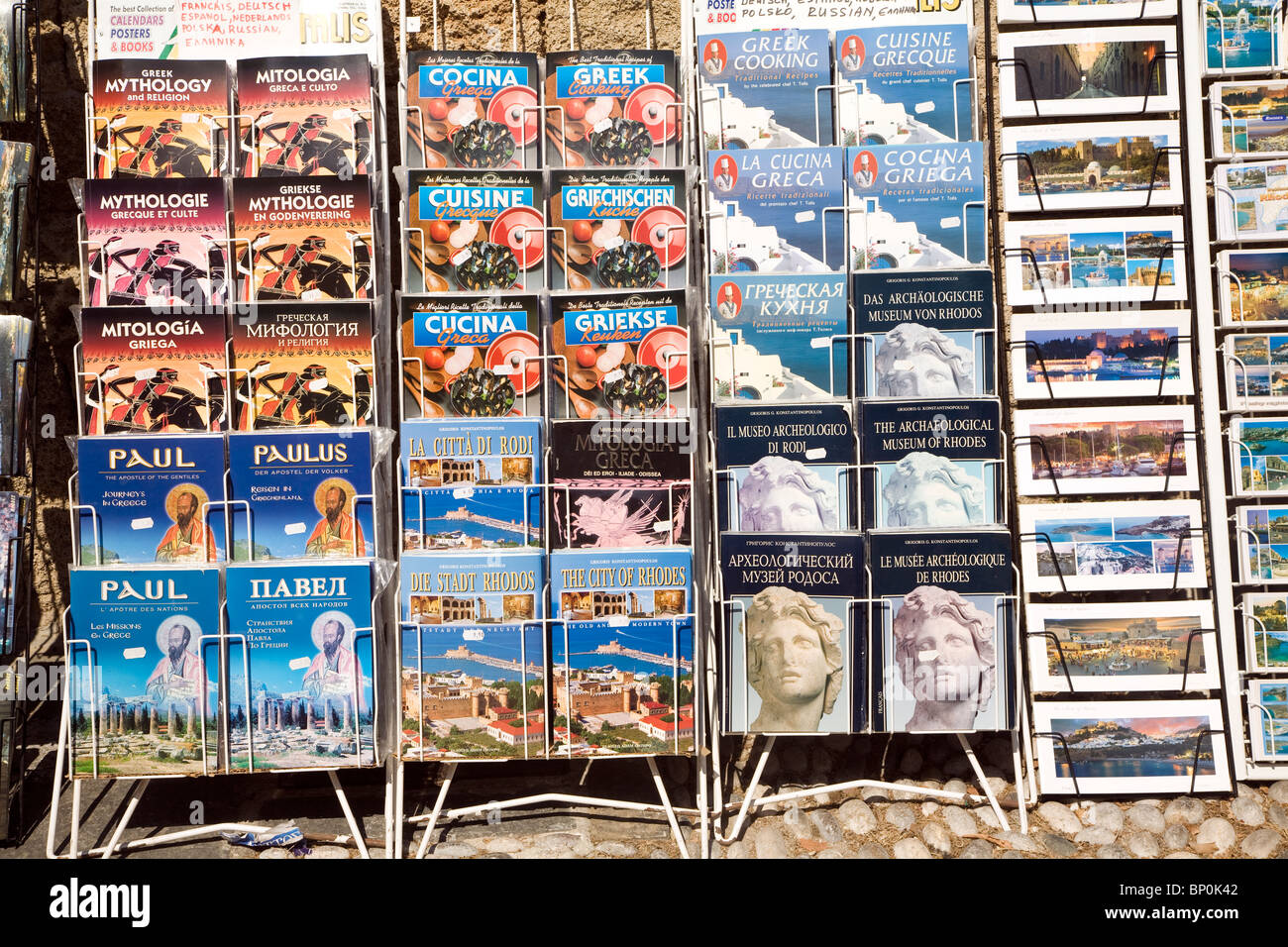 Postcards and guide books in display rack, Rhodes, Greece - Stock Image