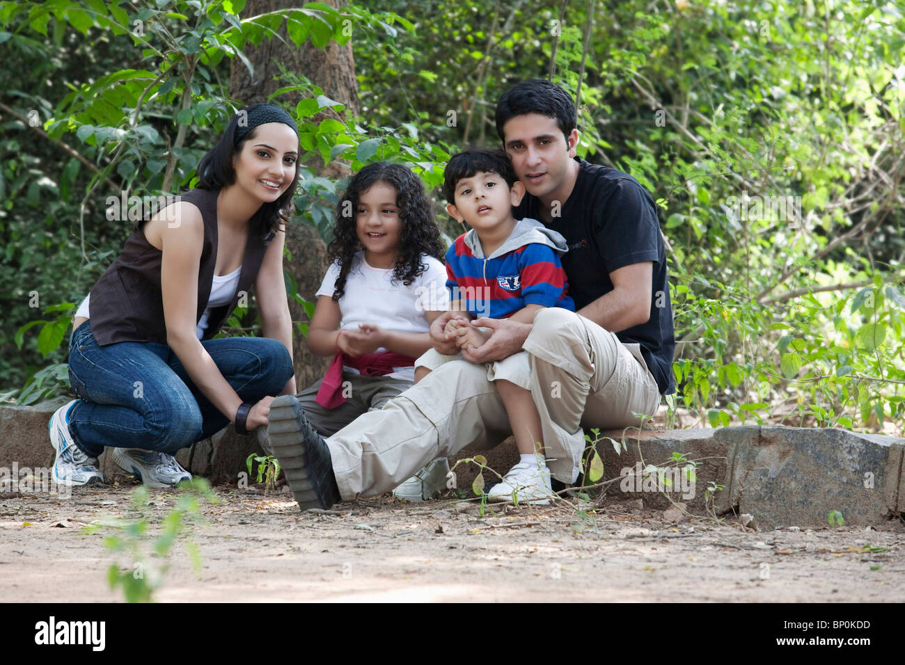 Portrait of a family in a park - Stock Image