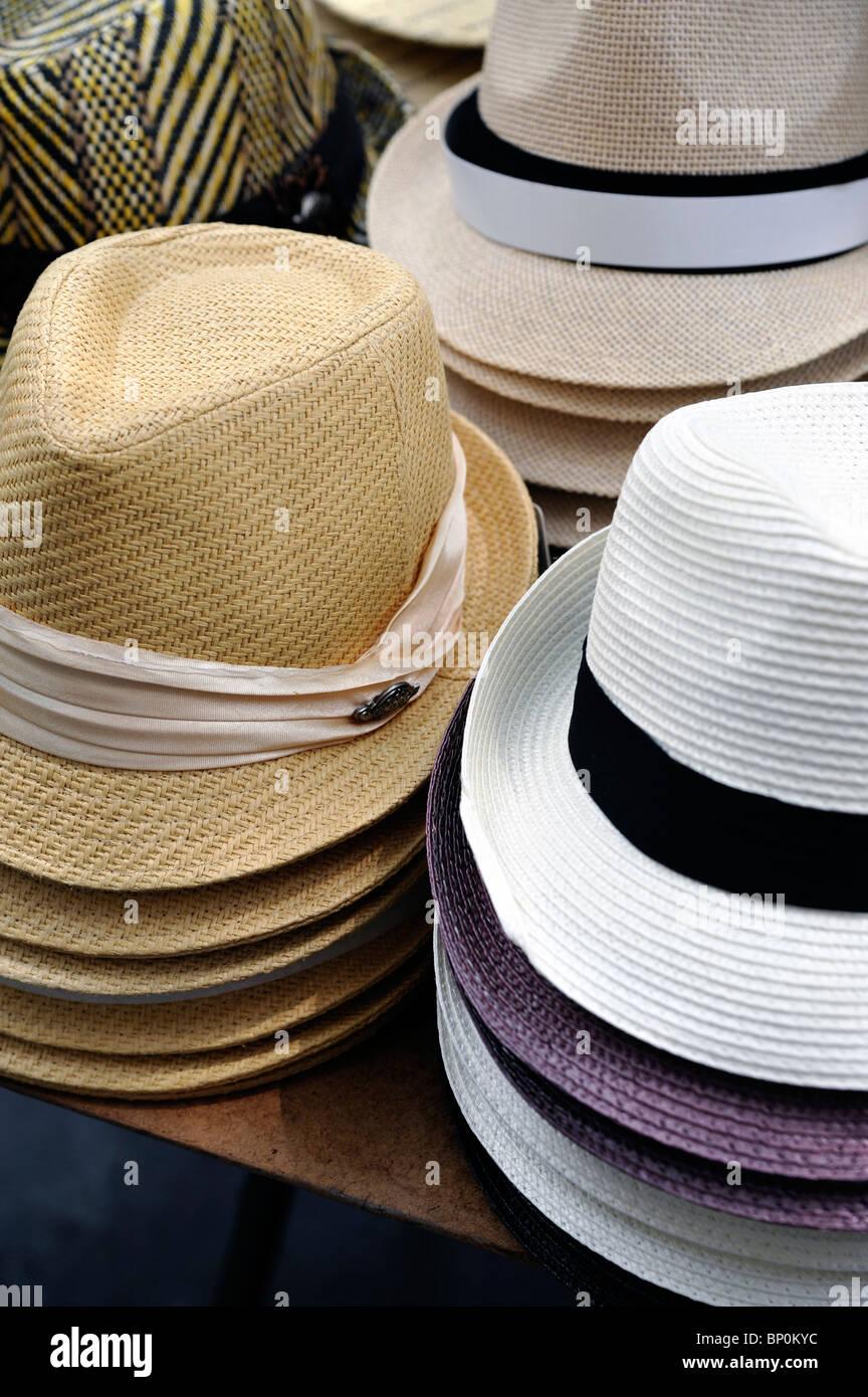 e0d679a3 Men's Fedora Straw Hats Display on a Sidewalk Vendor's Table Stock ...