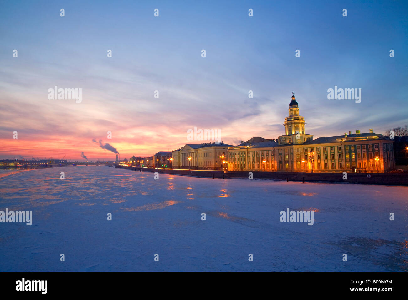 Russia, St. Petersburg; The last light over the partly frozen Neva River with the 'Kunstkamera' prominent in the - Stock Image