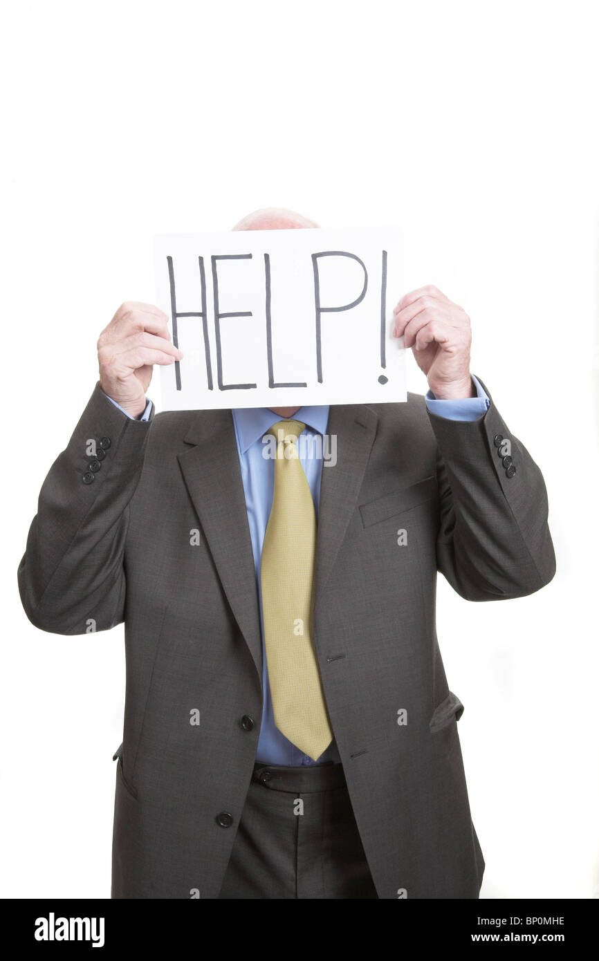 Businessman holding sign saying Help! - Stock Image