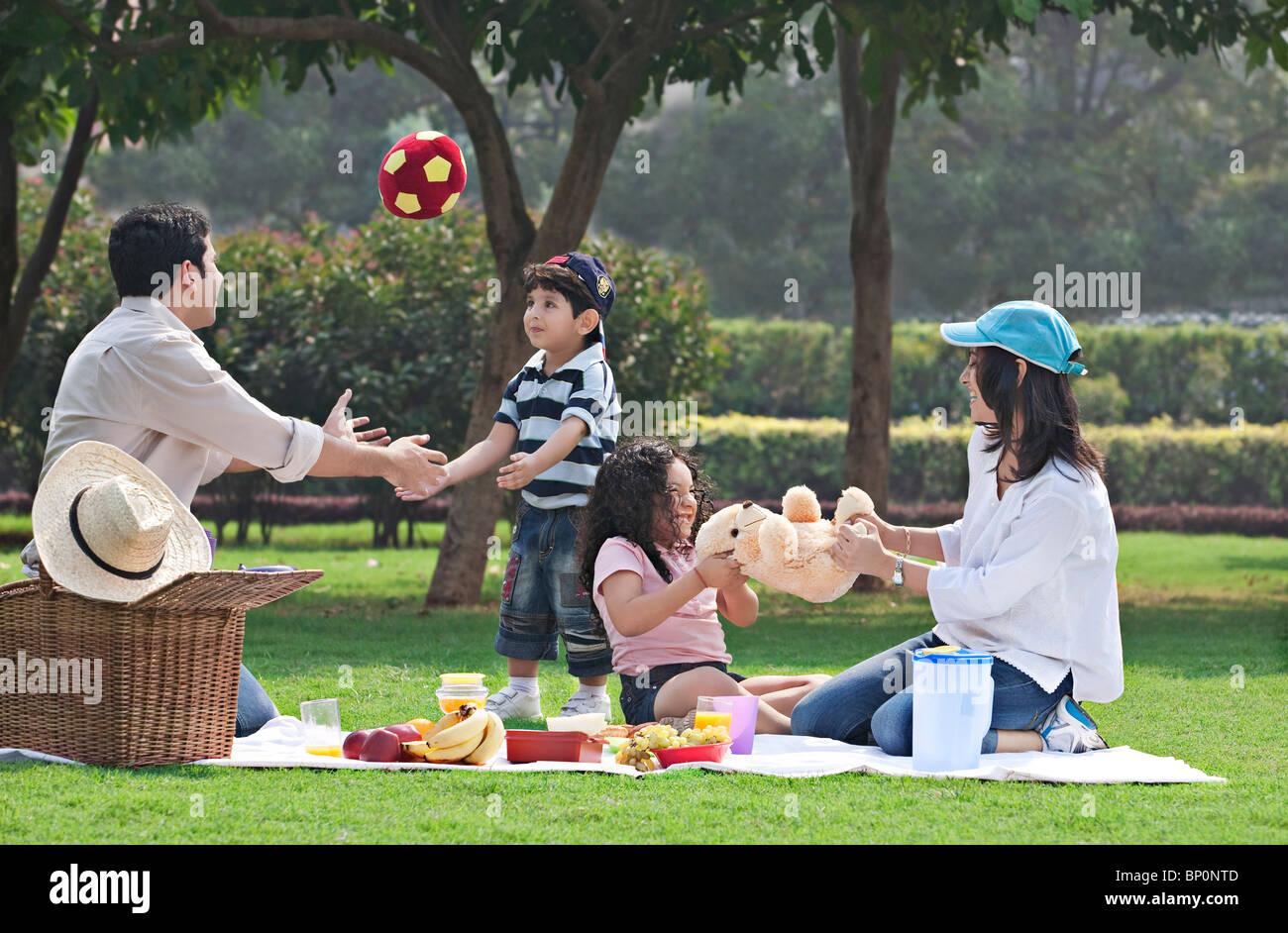Family having fun at a picnic - Stock Image