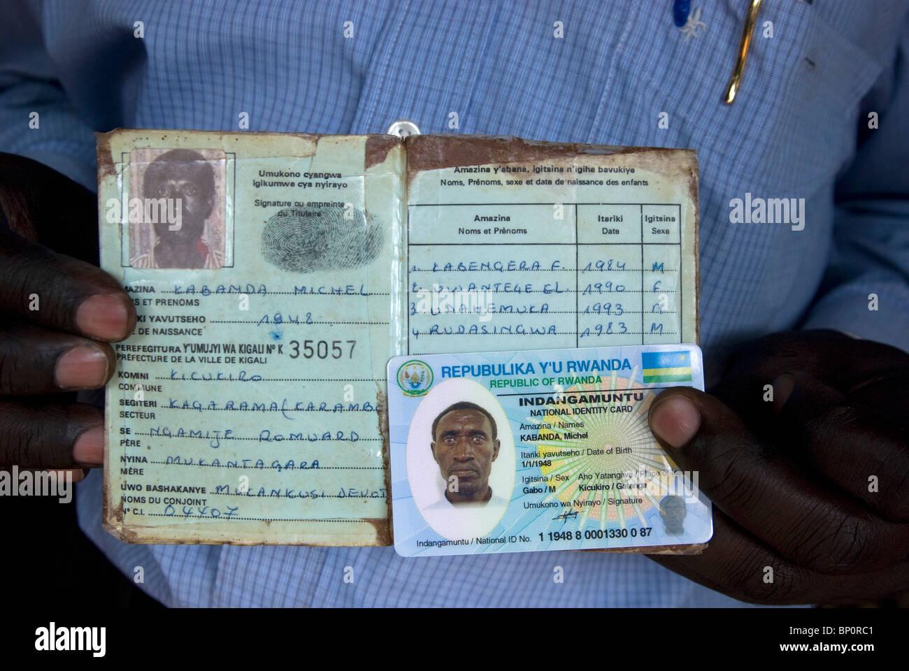 Rwanda, man showing Identity Cards - Stock Image