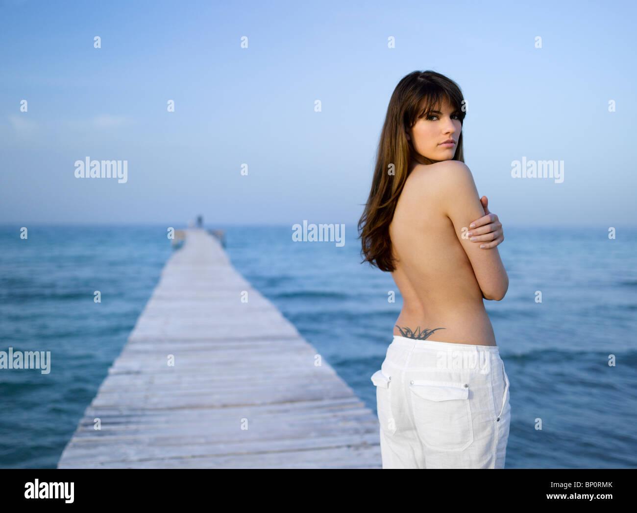 Woman on pontoon - Stock Image