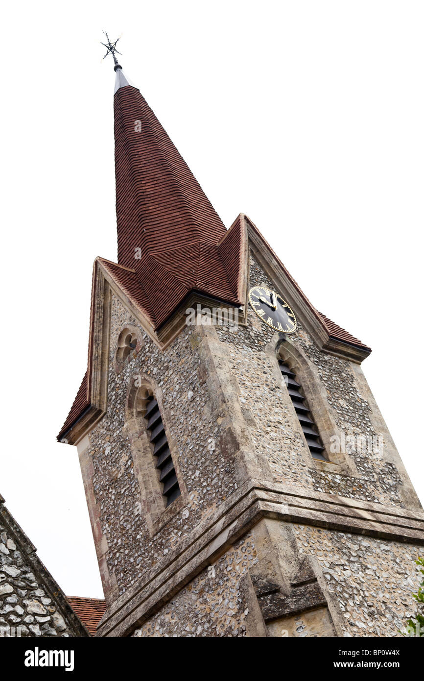 tiled spire on an english village church - Stock Image