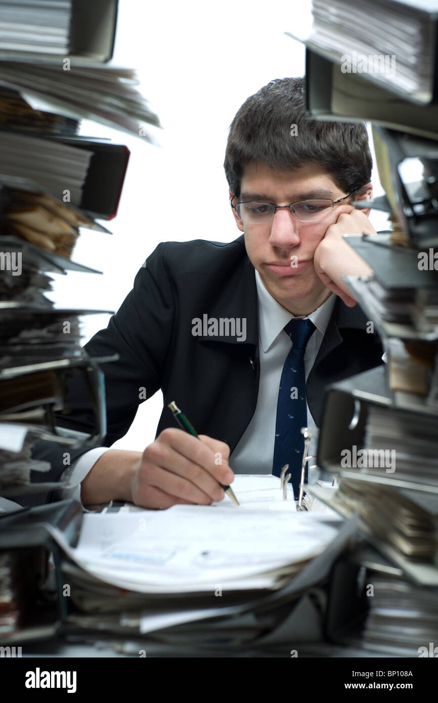 Desperate bookkeeper at work - Stock Image