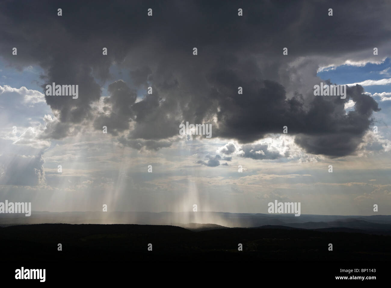aerial view above rain showers pouring from cumulonimbus clouds outside Atlanta Georgia - Stock Image