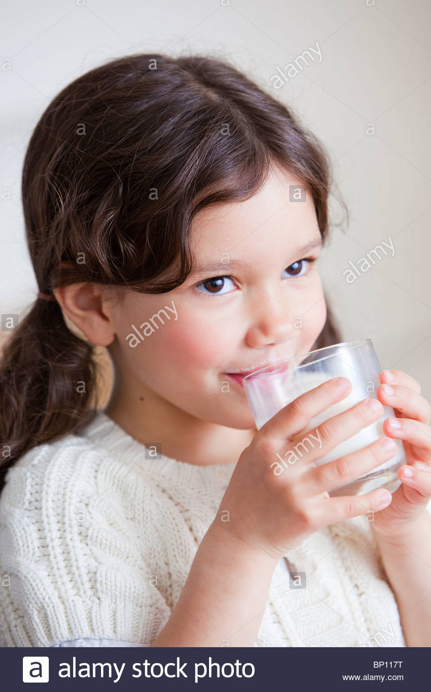 Beautiful young girl drinking milk - Stock Image