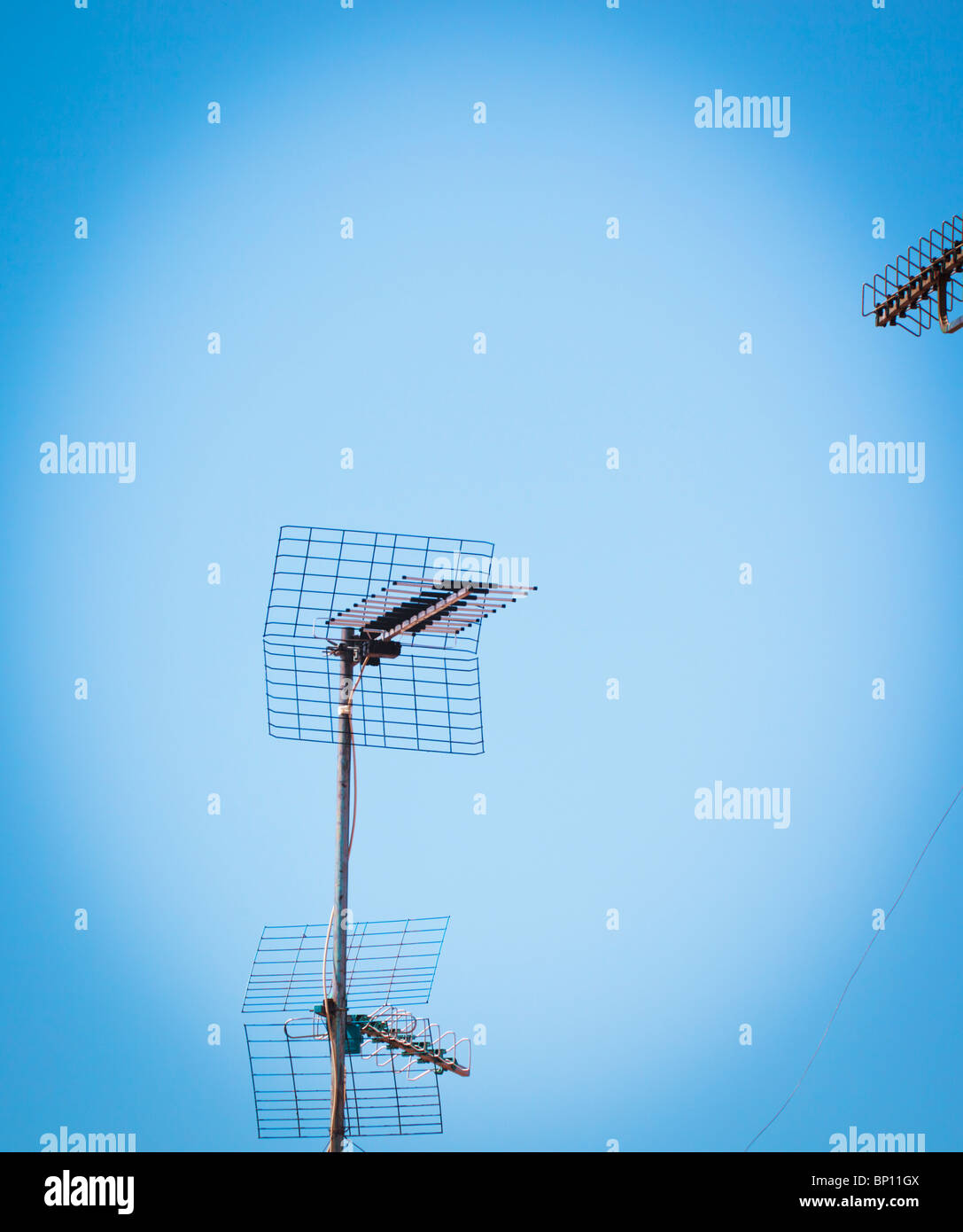 Television aerials on a roof. - Stock Image