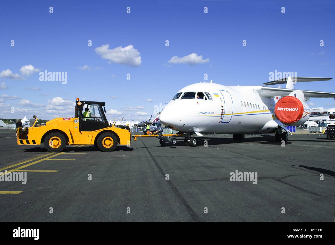 Antonov An-158 on tow at Farnborough Airshow - Stock Image