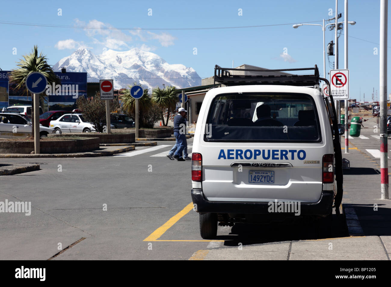 Minibus at El Alto airport (LPB, the highest international airport in the world) , Mt Illimani in background , La - Stock Image