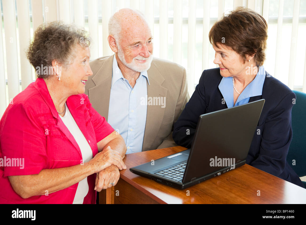 seniors discuss their retirement with a financial advisor stock