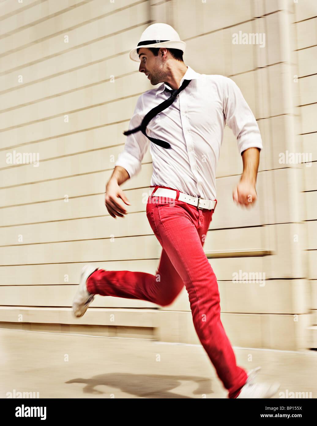 Man in tie running - Stock Image