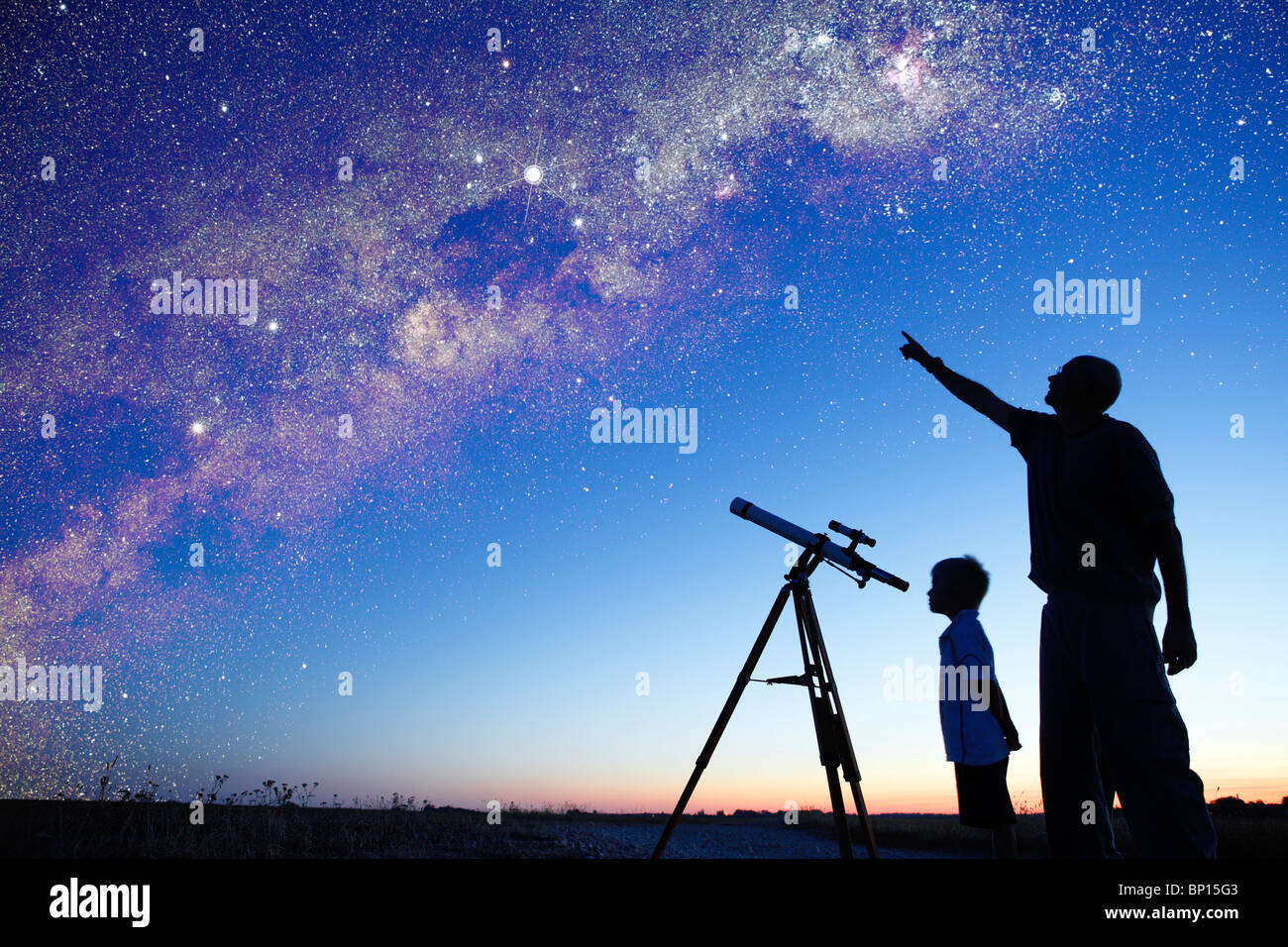 Man showing milky way to little boy, telescope - Stock Image