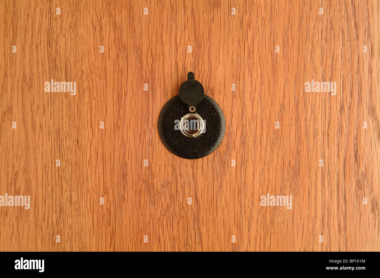 The spy hole on wooden doors - Stock Image