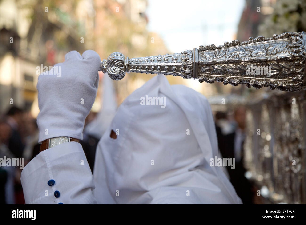 A believer in a procession on Palm Sunday, Seville, Spain - Stock Image