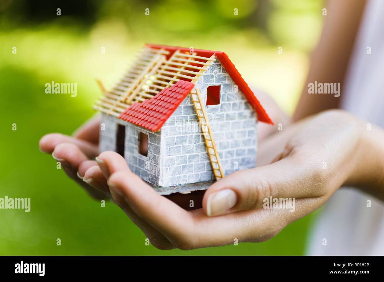 Young woman holding model house Stock Photo