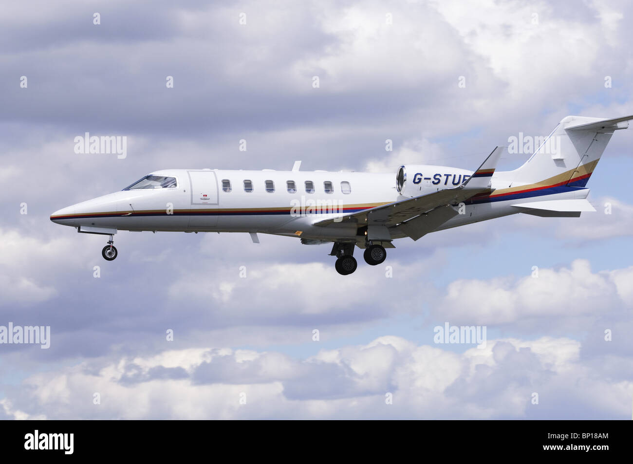 Bombardier Learjet 40 operated by TAG Aviation on approach for landing at Farnborough Airport - Stock Image