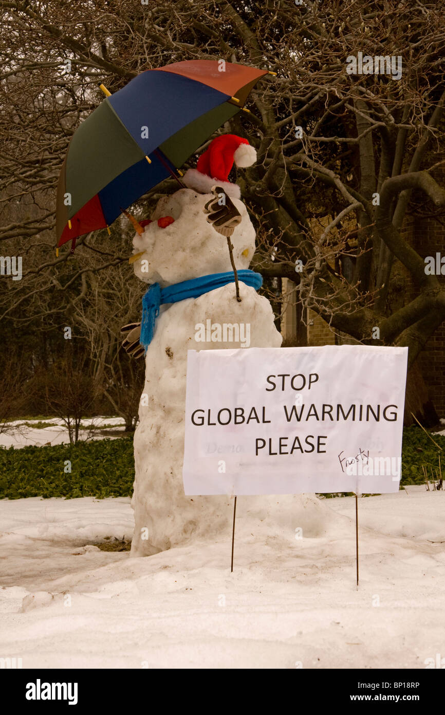 A snowperson takes a stand against global warming. - Stock Image