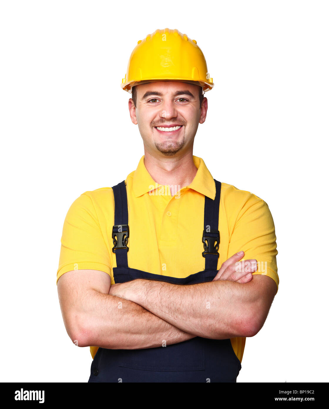 smiling manual worker isolated on white background - Stock Image