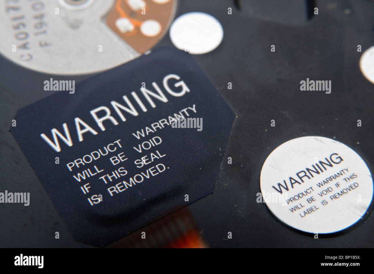 Label on the outside of a hard disk drive 'Warning. Product warranty will be void if this seal is removed' - Stock Image